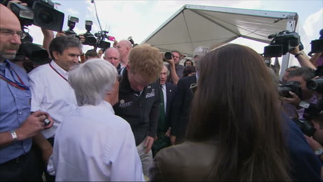 exterior shots prince harry walks with damon hill & sir jackie stewart & greets bernie ecclestone. exterior shots prince harry walks into the red... - bernie ecclestone stock videos & royalty-free footage