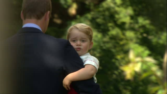 exterior shots prince william carrying prince george after christening of princess charlotte of cambridge. prince george looks back at following... - 2015 stock videos & royalty-free footage