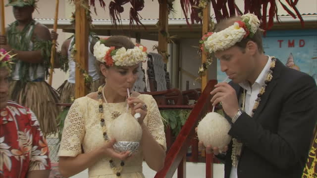 exterior shots prince william catherine duchess of cambridge drink juice through straws from fresh cocunuts given to them by tribal elder william... - royal tour stock videos & royalty-free footage