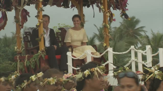exterior shots prince william & catherine, duchess of cambridge sit down on carriage seat with a thatched roof of leaves & are lifted shoulder high... - thatched roof stock videos & royalty-free footage
