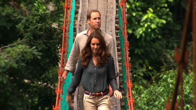 Exterior shots Prince William Catherine Duchess of Cambridge walk across rope bridge in rainforest Exterior shots William Catherine wearing hard hats...