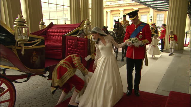 exterior shots prince william & catherine middleton enter buckingham palace in state carriage. interior shots prince william helps catherine... - celebrities video stock e b–roll