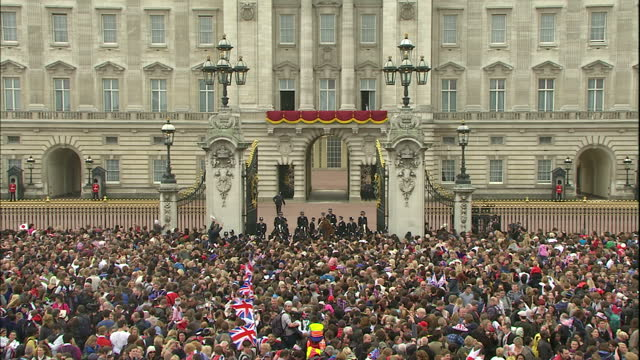 Exterior shots Prince William Catherine Middleton make final wave to the crowds before turning walking back into Buckingham Palace Exterior wide shot...