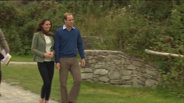 exterior shots prince william catherine walk talk to organiser catherine speaking to those taking part in race prince william catherine arriving at... - galles video stock e b–roll
