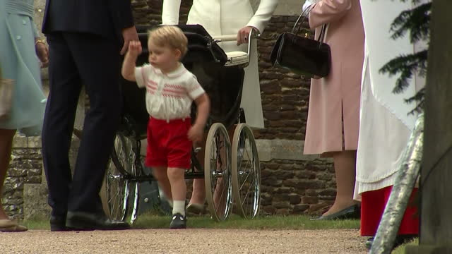 exterior shots prince william crouched down talking to prince george of cambridge outside church of st mary magdalene prince george walks off on july... - baptism stock videos & royalty-free footage