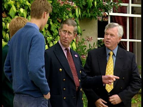 stockvideo's en b-roll-footage met exterior shots prince william drives car in front of highgrove house prince charles prince harry are watching on prince william drives nis new car l... - 1999