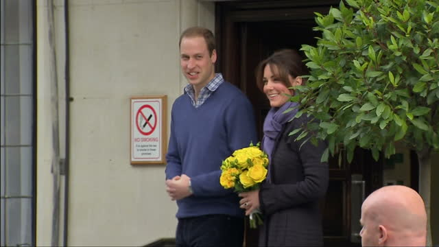 Exterior shots Prince William Duke of Cambridge and Catherine Duchess of Cambridge leave hospital and pose fro snappers before getting in waiting car...