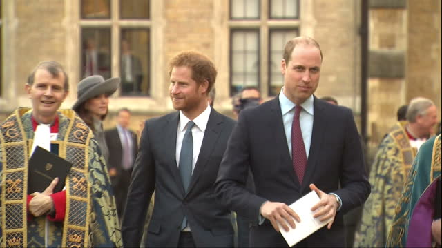 exterior shots prince william duke of cambridge and prince harry walk together along with members of the clergy with crowds of people gathered nearby... - prinz william herzog von cambridge stock-videos und b-roll-filmmaterial