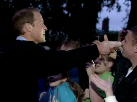 Exterior shots Prince William greets crowds of well wishers Royal Wedding watchers camped along The Mall the evening before the wedding Prince...