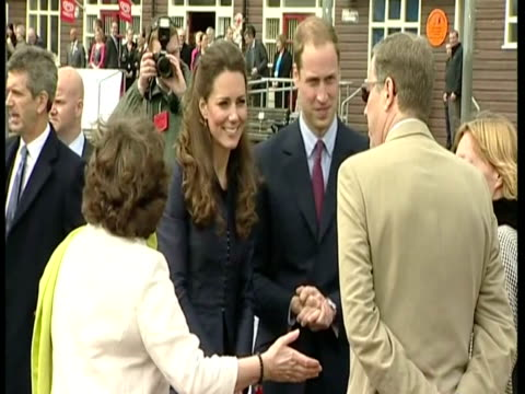 exterior shots prince william & kate middleton arrive at darwen aldridge academy sports track & greet officials before meeting & chatting with a... - ランカシャー点の映像素材/bロール