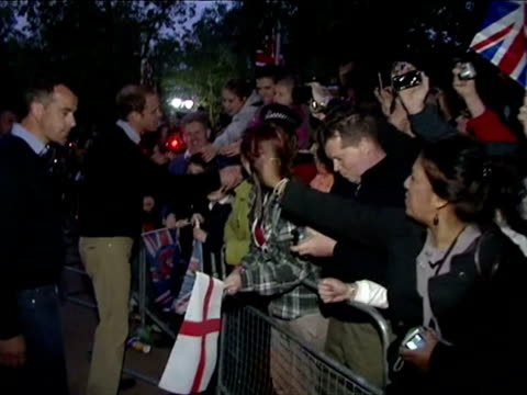 Exterior shots Prince William meets greets large crowds of well wishers camped out along The Mall the evening before the Wedding Prince William meets...