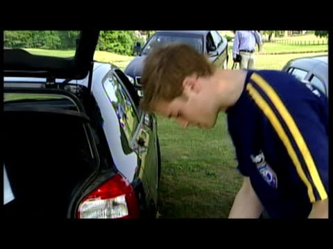 exterior shots prince william prince harry prepare for polo match polish and clean their polo boots prince william has forgotten his boots and prince... - prince william stock videos & royalty-free footage