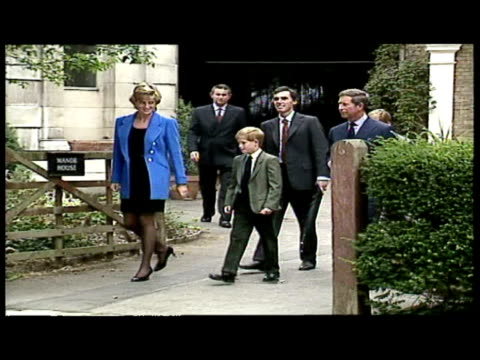 stockvideo's en b-roll-footage met exterior shots prince william prince harry princess diana prince charles arriving at eton interior shots prince wililam signing school pupil... - 1995