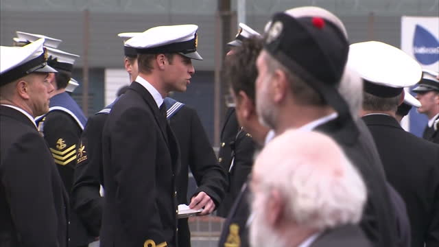 stockvideo's en b-roll-footage met exterior shots prince william prince of wales awarding special badges to naval officers who've carried out more than 20 tours of duty spending as... - meer dan 50 seconden