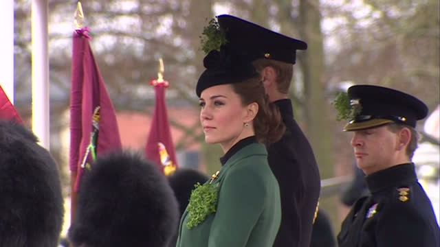 vidéos et rushes de exterior shots prince william the duke of cambridge catherine duchess of cambridge get out of car and present irish guards with shamrocks for st... - mons barracks