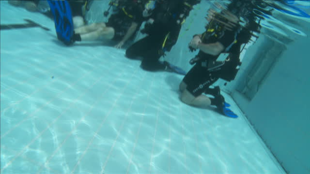 exterior shots prince william underwater scuba diving with other divers giving the 'all good' symbol with their hands. on july 09, 2014 in london,... - aqualung diving equipment video stock e b–roll