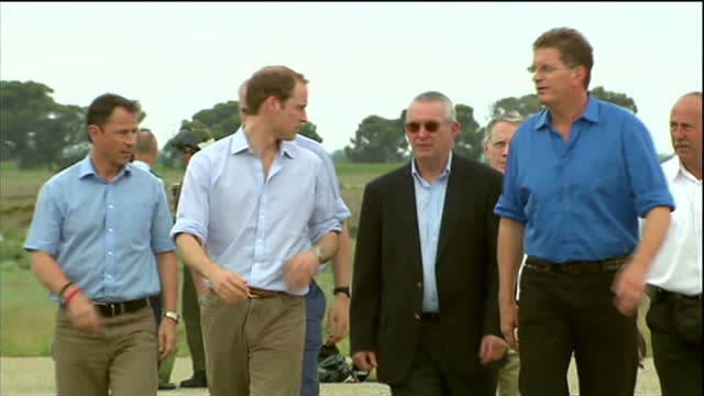 exterior shots prince william walks along tarmac to waiting car haves to cheering crowds of well wishers prince william visits flood wrecked kerang... - privatfahrzeug stock-videos und b-roll-filmmaterial
