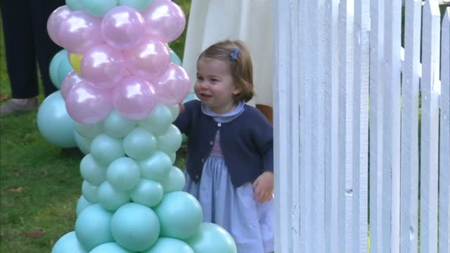Exterior shots Princess Charlotte playing with balloons with Catherine Duchess of Cambridge shots of Prince George Prince William Duke of Cambridge...