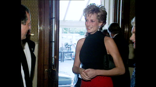 exterior shots princess diana arrives for pavarotti concert , diana enters foyer & shakes hands with lady, then turns and is introduced to line-up,... - sleeveless top stock videos & royalty-free footage
