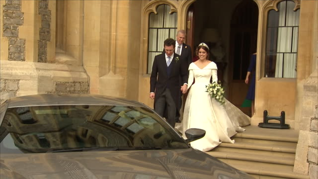 exterior shots princess eugenie and jack brooksbank helped by princess beatrice and prince andrew, duke of york, sarah, duchess of york leave windsor... - celebrities video stock e b–roll