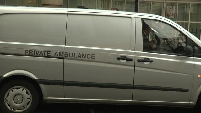 vídeos de stock e filmes b-roll de exterior shots private ambulance parked outside block of flats with police officers stood outside the presenters of an australian radio show who made... - aparelhagem de áudio