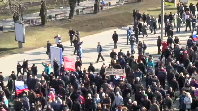 Exterior shots Pro Russian demonstrators marching carrying Russia flags on March 09 2014 in Donetsk Ukraine