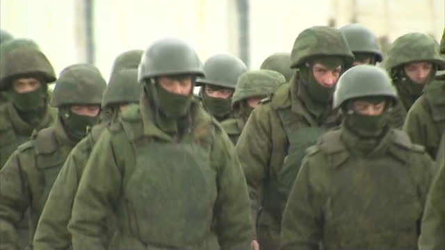 exterior shots pro russian soldiers marching in the streets on march 05 2014 in various cities ukraine - nato stock videos & royalty-free footage