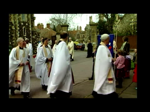 exterior shots procession of clergymen led into canterbury cathedral for easter service, archbishop of canterbury, rowan williams, at rear. interior... - archbishop of canterbury stock videos & royalty-free footage