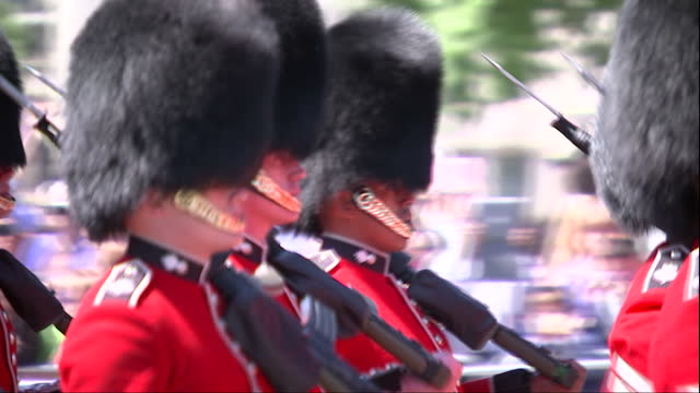 exterior shots procession of guardsman ceremonial military band on state opening of parliament day passing camera on may 27 2015 in london england - the queen's speech state opening of uk parliament stock-videos und b-roll-filmmaterial