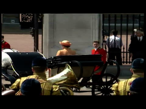 exterior shots procession with queen carried in carriage to raised dais exterior shots queen elizabeth ii taking salute as brigade of guards march... - 1992 stock videos & royalty-free footage