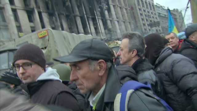 Exterior shots protesters in riot gear arriving in Independence square on February 23 2014 in Kiev Ukraine