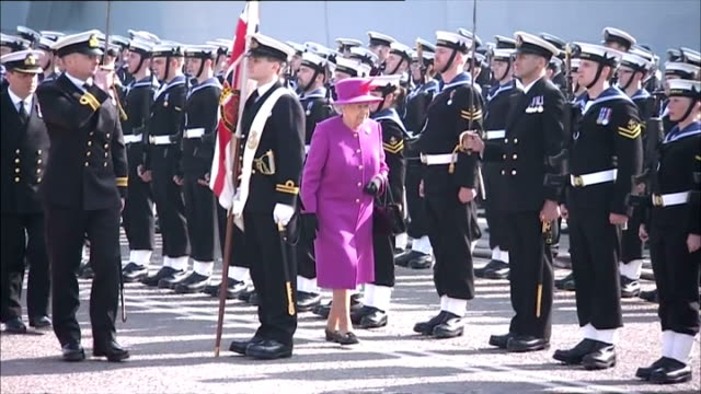 exterior shots queen elizabeth ii inspecting the royal navy guard of honour at hmnb devonport plymouth whilst on visit hms ocean on march 20 2015 in... - elizabeth i of england stock videos & royalty-free footage