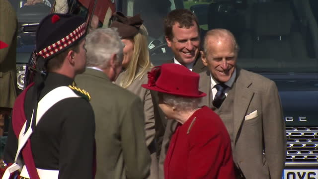 Exterior shots Queen Elizabeth II Prince Philip Duke of Edinburgh and Prince Charles Prince of Wales exit vehicle to be met by Games officials and...