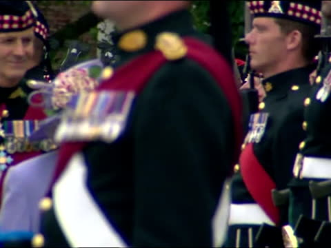 exterior shots queen elizabeth ii walk along line of the argyll sutherland highlanders 5th battalion soldiers standing to attention the queen meets... - kent england stock videos & royalty-free footage