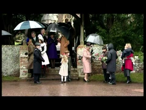 exterior shots queen elizabeth ii walks down steps holding her own umbrella followed by members of royal family including princess eugenie with... - 2007 stock videos and b-roll footage