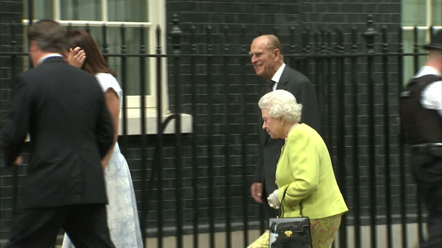 exterior shots queen elizabeth prince philip arrive at downing street greet david samantha cameron all pose for photo call in front of no 10 door... - デビッド・キャメロン点の映像素材/bロール