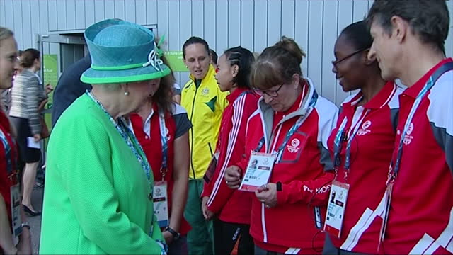 exterior shots queen walking along line and talking with commonwealth games workers - commonwealth games stock videos & royalty-free footage