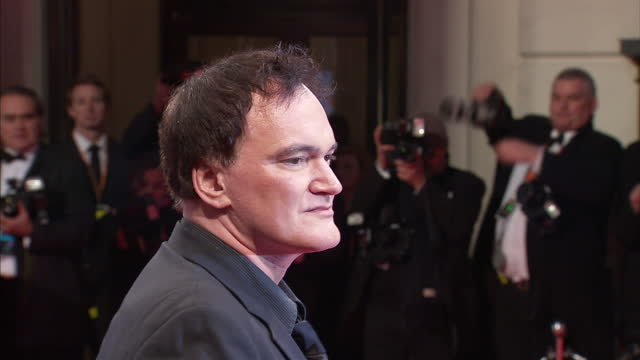 Exterior shots Quentin Tarantino arrives and poses on red carpet The Bafta Television Awards Red Carpet Arrivals at London Palladium on June 06 2010...
