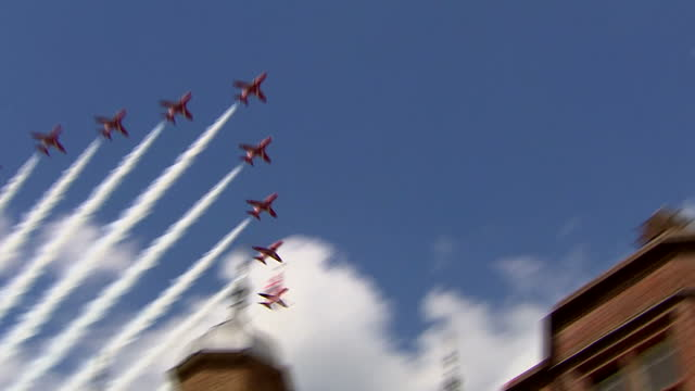 exterior shots raf red arrows, royal air force aerobatic team flying overhead with smoke trailing during armed forces day parade. on june 27, 2015 in... - guildford stock videos & royalty-free footage