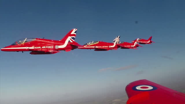 exterior shots red arrows jet moved out of a hangar at raf scampton gopro point of view red arrows in flight performs aerobatics exterior interview... - acrobazia video stock e b–roll