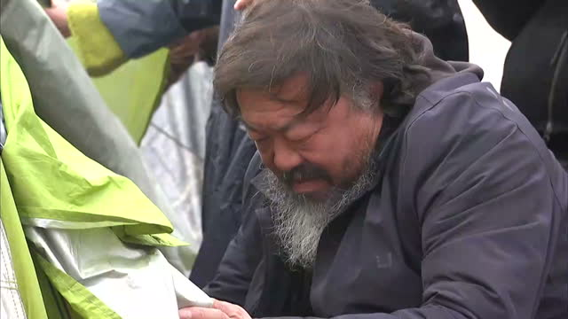 Exterior shots refugee children migrants inside Idomeni camp Ai Weiwei Artist and Activist inspecting camp on March 17 2016 in Idomeni Greece