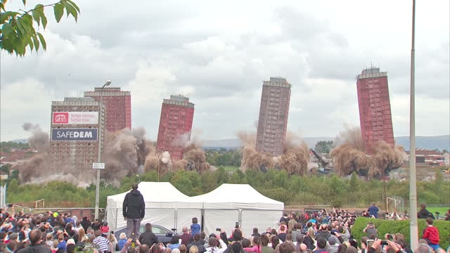 exterior shots residential tower blocks in glasgow are demolished in controlled demolition with large crowds watching on. several of the towers do... - office block exterior stock videos & royalty-free footage