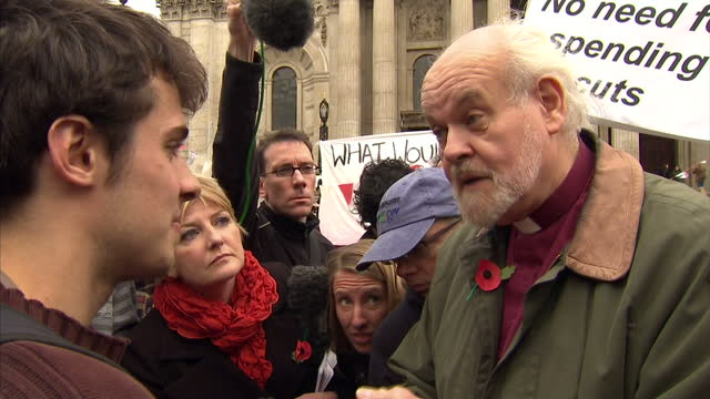 exterior shots reverend richard chartres bishop of london having a heated debate with a protester over the continued occupation of the land in front... - bishop of london stock videos & royalty-free footage