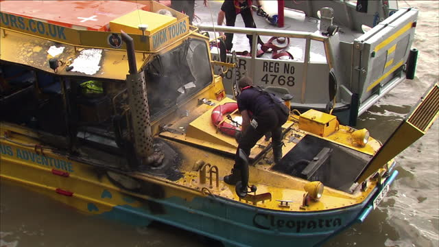 exterior shots river fire boat attends to duck tours cleopatra includes footage of damage to the boat fireman venting smoke people inside a rigid... - cleopatra stock videos & royalty-free footage