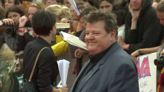 Exterior shots Robbie Coltrane poses on the red carpet at the Harry Potter the Deathly Hallows Part 2 premier Robbie Coltrane poses on the Red Carpet...