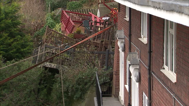 exterior shots row of cottages of cliff edge with emergency service workers at the site preparing for demolishing work work began today to demolish 5... - whitby north yorkshire england stock videos & royalty-free footage