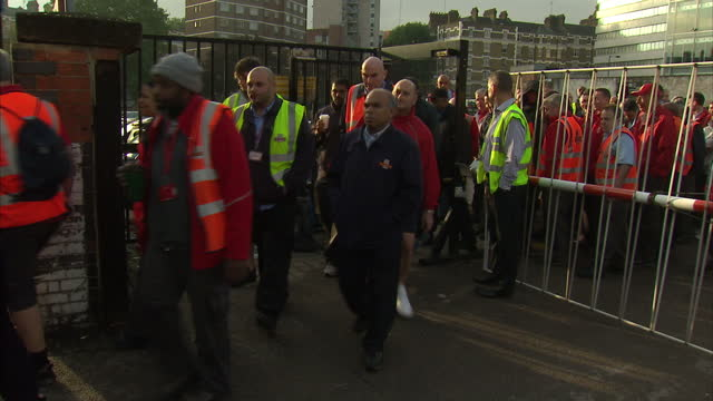 exterior shots royal mail workers leaving work at the end of their shift. includes shots of man handing out copies of the socialist worker newspaper.... - newspaper strike stock videos & royalty-free footage