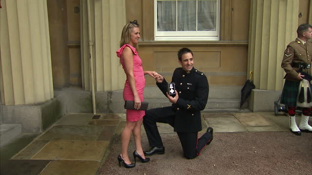 exterior shots royal marine mark jackson gets on one knee to propose to girlfriend pose for snappers after receiving the conspicuous gallantry cross... - the conspicuous gallantry cross stock videos and b-roll footage