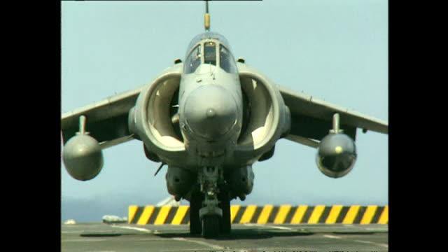 exterior shots royal navy sea harrier fighter jets taking off from flight deck of hms invincible aircraft carrier on july 12 2000 at sea - hospital corpsman点の映像素材/bロール