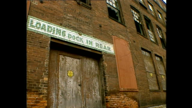 exterior shots rundown neglected and abandoned factories along the detroit river on march 12 1994 in detroit michigan - ruine stock-videos und b-roll-filmmaterial